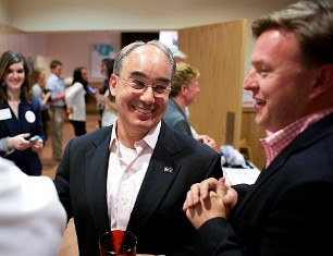 BANGOR, MAINE -- 06/10/2014 -- Bruce Poliquin, former state treasurer, talks with Brent Littlefield, right, along with other supporters of his campaign during election night at Dysarts in Bangor. Early 2nd Congressional District seat results showed former State Treasurer Bruce Poliquin opening a lead over former Senate President Kevin Raye. Brian Feulner| BDN